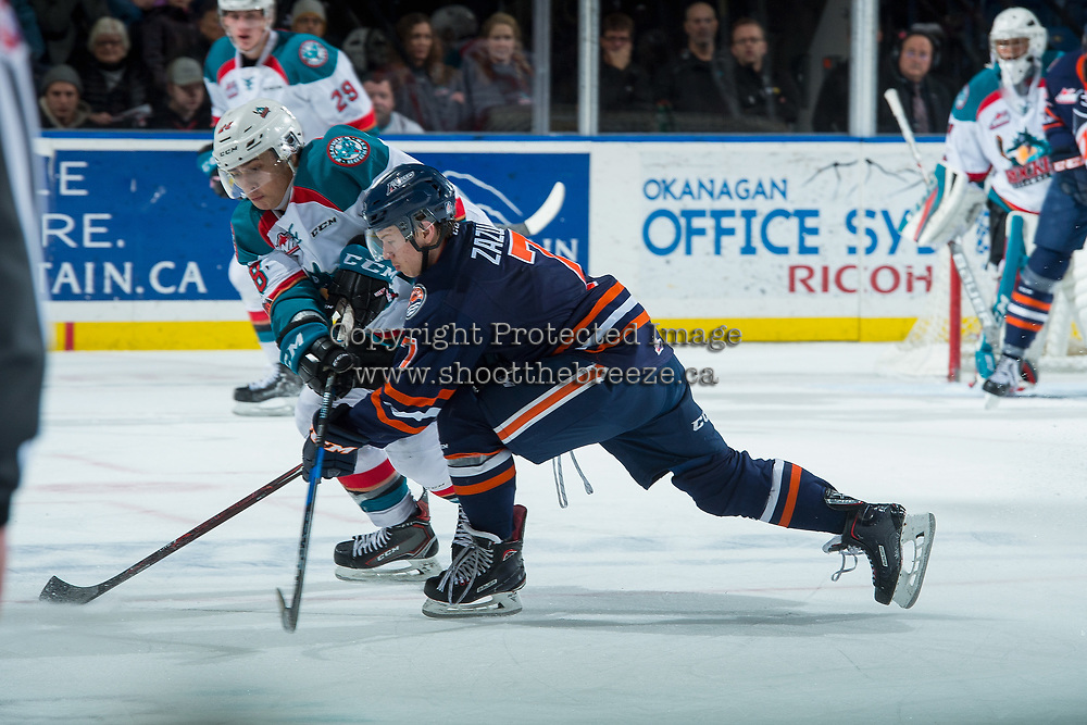 KELOWNA, CANADA - DECEMBER 27: Luke Zazula #7 of the Kamloops Blazers checks Leif Mattson #28 of the Kelowna Rockets during third period on December 27, 2017 at Prospera Place in Kelowna, British Columbia, Canada.  (Photo by Marissa Baecker/Shoot the Breeze)  *** Local Caption ***