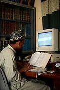 Abdul Razzaq, coordinator of the Darul Uloom Naeemia, types and compiles the Islamic book of Hadhees on a computer in Karachi, Pakistan.