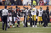 Pittsburgh Steelers quarterback Ben Roethlisberger (7) looks on as NFL officials try to clear the field of players and coaches after a hard hit on Pittsburgh Steelers wide receiver Antonio Brown (84) at the end of the game by Cincinnati Bengals outside linebacker Vontaze Burfict (55) that causes altercations on the field during the NFL AFC Wild Card playoff football game against the Cincinnati Bengals on Saturday, Jan. 9, 2016 in Cincinnati. The Steelers won the game 18-16. (©Paul Anthony Spinelli)