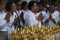 May 10, 2017 - Bangkok, Bangkok, Thailand - People pray before giving offerings to Thai Buddhist monks on the occasion of Visakha Bucha Day in Bangkok, Thailand, on 10 May 2017. Visakha Bucha Day on the full-moon day of the sixth lunar month an annual celebration of Buddha's birth, enlightenment and death, at a temple in Bangkok. (Credit Image: © Anusak Laowilas/NurPhoto via ZUMA Press)