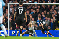MANCHESTER, ENGLAND - Wednesday, March 24, 2010: Everton's goalkeeper Tim Howard is beaten by Manchester City's Carlos Tevez but team-mate Phil Jagielka clears the ball off the line during the Premiership match at the City of Manchester Stadium. (Photo by David Rawcliffe/Propaganda)