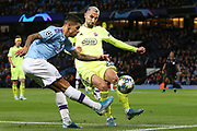 Manchester City defender Joao Cancelo (27) gets the cross in past Dinamo Zagreb defender Marin Leovac (22) during the Champions League match between Manchester City and Dinamo Zagreb at the Etihad Stadium, Manchester, England on 1 October 2019.