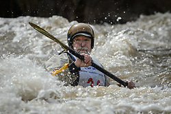 Frank Wentz of Kirkwood, Mo. races in the K1 Men's 60 and up class on the slalom course of the 45th Annual Missouri Whitewater Championships. Wentz placed second in the class and seventh in the K1 Men's Long Plastic (30 and up) class. The Missouri Whitewater Championships, held on the St. Francis River at the Millstream Gardens Conservation Area, is the oldest regional whitewater slalom race in the United States. Heavy rain in the days prior to the competition sent water levels on the St. Francis River to some of the highest heights that the race has ever been run. Only expert classes were run on the flood level race course.