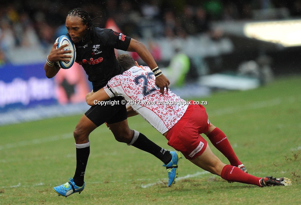 Odwa Ndungane of the Mr Price Sharks, Luke Morahan of the Reds<br /> &copy;Backpagepix