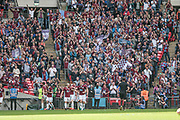 The South Shields players celebrate in front of their fans as South Shields Gavin Cogdon (9)  scores a goal and increases their lead to 2-0 with under ten minutes remaining of the final during the FA Vase match between Cleethorpes Town and South Shields at Wembley Stadium, London, England on 21 May 2017. Photo by Mark P Doherty.