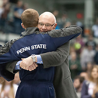 February 23, 2014; State College, PA, USA; Penn State athletic director David Joyner hugs David Taylor after he was introduced to a sell-out crowd at Rec Hall during senior recognition before the Nittany Lions match against the Clarion Eagles. Penn State defeated Clarion 43-3.