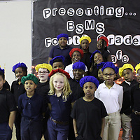 Belle-Shivers Middle School fourth-graders pose for pictures following their poetry cafe at the Fluker Reed Auditorium. Each Thursday in February, classes have shared their original poetry.