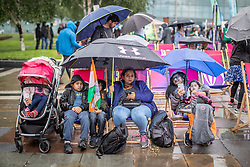 © Licensed to London News Pictures. 16/06/2019. Manchester, UK. Rain stops play as cricket fans watch India play Pakistan on a live screen in Cathedral Gardens , as the the two sides meet in the ICC Cricket World Cup at Old Trafford . Photo credit: Joel Goodman/LNP