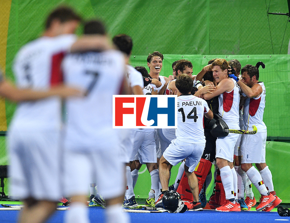 Belgium's players celebrate winning the men's semifinal field hockey Belgium vs Netherlands match of the Rio 2016 Olympics Games at the Olympic Hockey Centre in Rio de Janeiro on August 16, 2016.  / AFP / Carl DE SOUZA        (Photo credit should read CARL DE SOUZA/AFP/Getty Images)