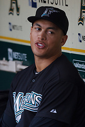 June 28, 2011; Oakland, CA, USA; Florida Marlins right fielder Mike Stanton (27) sits in the dugout during a rain delay before the game against the Oakland Athletics at the O.co Coliseum.  Oakland defeated Florida 1-0.