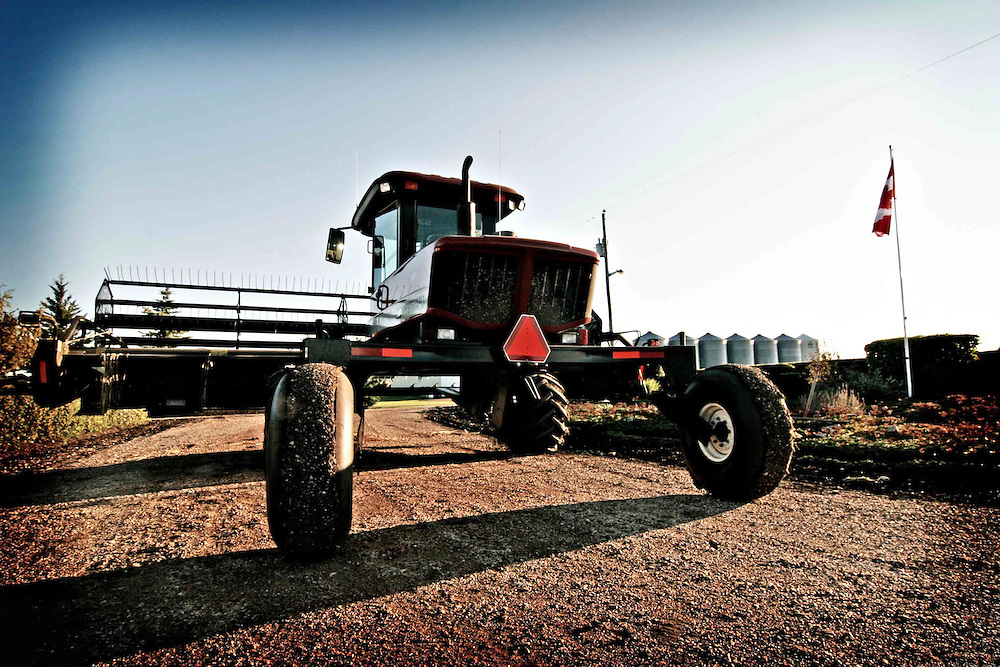 A swather is parked in a farmyard near Birch Hills, Saskatchewan.