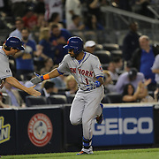 Chris Young, New York Mets, after his two run homer put the Mets ahead in the eighth inning during the New York Yankees V New York Mets, Subway Series game at Yankee Stadium, The Bronx, New York. 12th May 2014. Photo Tim Clayton