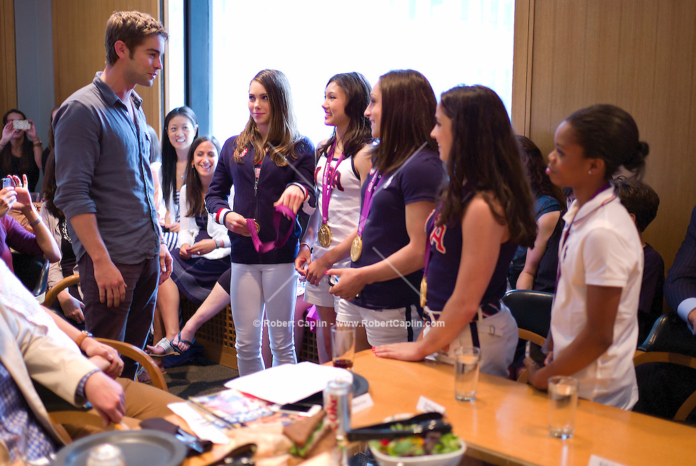 Actor Chace Crawford  meets the 2012 U.S. Olympic Gymnastics Team Members Gabby Douglas, McKayla Maroney, Aly Raisman, Kyla Ross, and Jordyn Wieber visit the offices of US Weekly Magazine after winning Gold in London. .. Photo by Robert Caplin
