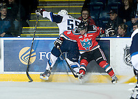 KELOWNA, CANADA - NOVEMBER 24:  Filip Vasko #10 of the Kelowna Rockets checks Nelson Nogier #55 of the  Saskatoon Blades into the boards at the Kelowna Rockets on November 24, 2012 at Prospera Place in Kelowna, British Columbia, Canada (Photo by Marissa Baecker/Shoot the Breeze) *** Local Caption ***