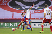 Sheffield United forward Che Adams  tackles Oldham Athletic forward Daniel Philliskirk   during the The FA Cup match between Sheffield Utd and Oldham Athletic at Bramall Lane, Sheffield, England on 5 December 2015. Photo by Simon Davies.