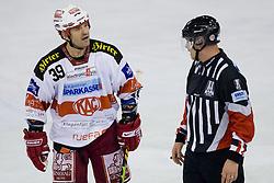 Jeffery Shantz (EC KAC, #39) and referee Wolfgang Fussi during ice-hockey match between HDD Tilia Olimpija and EC KAC in 12th Round of EBEL league, on October 17, 2010 at Hala Tivoli, Ljubljana, Slovenia. (Photo By Matic Klansek Velej / Sportida.com)
