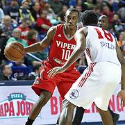 Rio Grande Valley Vipers Guard Jarvis Threatt (10) drives past Delaware 87ers Guard DJ Seeley (18) on defense in the first half of a NBA D-league regular season basketball game between the Delaware 87ers and the Rio Grande Valley Vipers (Houston Rockets) Saturday, Dec. 27, 2014 at The Bob Carpenter Sports Convocation Center in Newark, DEL