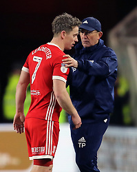 Middlesbrough's Grant Leadbitter (left) being subsituted off with a hamstring injury, being replaced by Middlesbrough's Adam Clayton (not pictured). Also seen Middlesbrough manager Tony Pulis. during the Sky Bet Championship match at the Riverside Stadium, Middlesbrough.