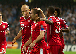 02.10.2013 Manchester, England.  Bayern Munich goalscorer Franck Ribery celebrates making it 1-0  with Arjen Robben during the Group D UEFA Champions League game between, Manchester City and Bayern Munich from the Etihad Stadium.