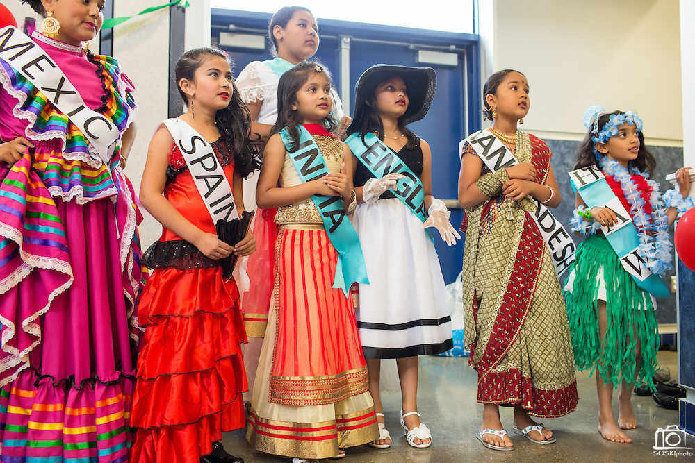 Students dressed in traditional attire from various parts of the world watch other students perform in a talent show during the Pomeroy Multicultural Festival at Pomeroy Elementary School in Milpitas, California, on April 25, 2015. (Stan Olszewski/SOSKIphoto)