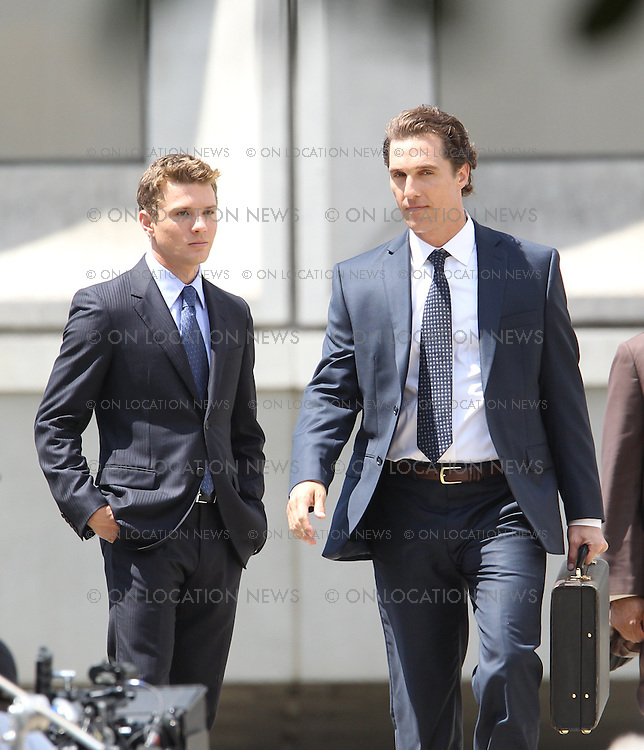 "July 16th 2010  Los Angeles, California. Non Exclusive. Two of Hollywood's most attractive men, Matthew McConaughey and Ryan Phillippe film a scene together for ""The Lincoln Lawyer"". The scene was filmed outside of a courthouse in Downtown LA. A crowd of women working in nearby offices gathered to watch and snap photos of  McConaughey and Phillippe as they filmed. McConaughey and Phillippe seemed to have great chemistry together as they hung out and joked around together during filming breaks.Photo by Eric Ford/On Location News 818-613-3955 info@onlocationnews.com"