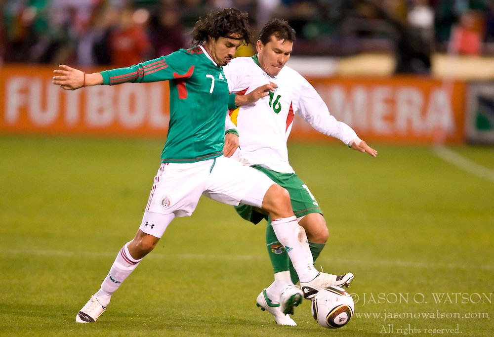 February 24, 2010; San Francisco, CA, USA;  Mexico midfielder Braulio Luna (7) and Bolivia defender Nicolas Suarez (16) fight for the ball during the first half at Candlestick Park. Mexico defeated Bolivia 5-0.