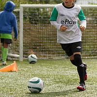 Eoin Byrne dribbling the ball at the FAI Eflow Summer Soccer School in Lisdoonvarna