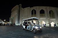 10 APR 2013, DOHA/QATAR<br /> Besucher fahren in kleinen Elektrowagen vor dem Amphitheater durch Katara Cultural Village, das neu geschaffene kulturelle Zentrum von Doha und Qatar<br /> IMAGE: 20130410-01-098<br /> KEYWORDS: Katar, Kultur, culture