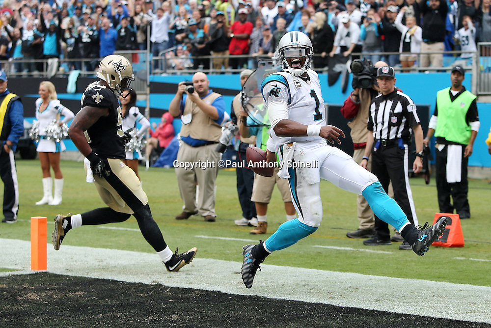 Carolina Panthers quarterback Cam Newton (1) high steps into the end zone as he scores a touchdown on a keeper that gives the Panthers a 27-16 fourth quarter lead during the 2015 NFL week 3 regular season football game against the New Orleans Saints on Sunday, Sept. 27, 2015 in Charlotte, N.C. The Panthers won the game 27-22. (©Paul Anthony Spinelli)