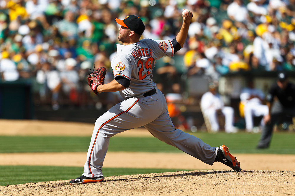 OAKLAND, CA - SEPTEMBER 16: Tommy Hunter #29 of the Baltimore Orioles pitches against the Oakland Athletics during the fifth inning at O.co Coliseum on September 16, 2012 in Oakland, California. The Baltimore Orioles defeated the Oakland Athletics 9-5. (Photo by Jason O. Watson/Getty Images) *** Local Caption *** Tommy Hunter