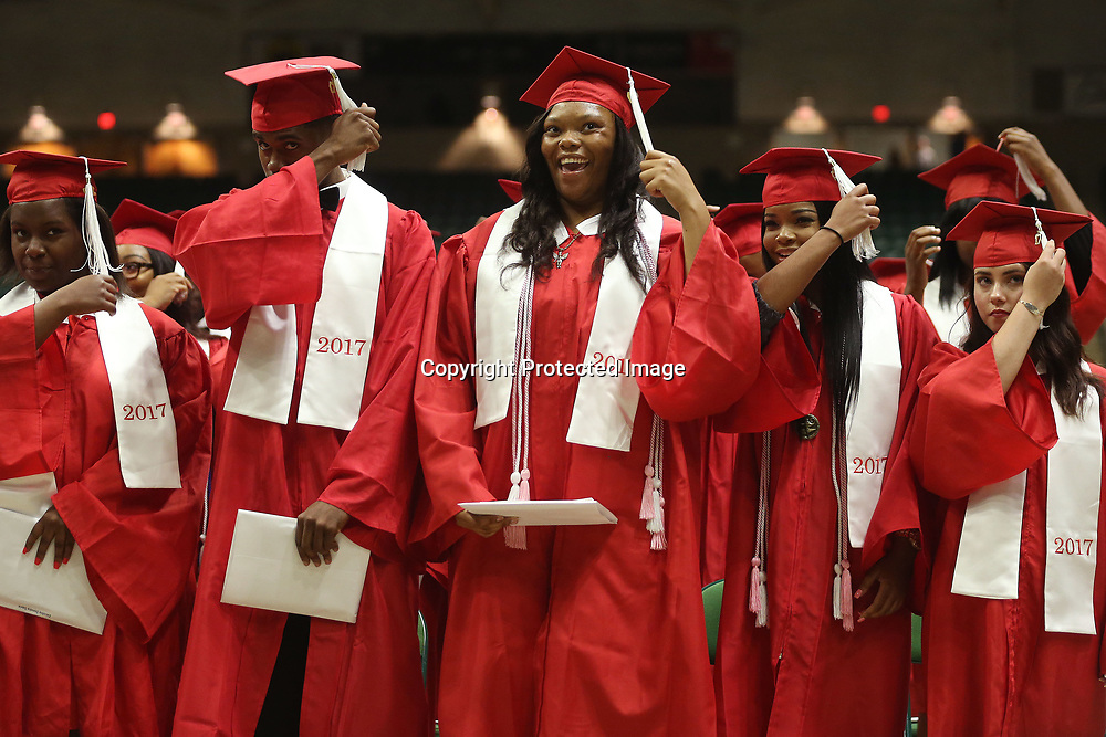 Shannon High School's Tyundrea Dilworth, center, and her classmates move their tassels from to the left at the conclusion of Shannon's graduation ceremony Saturday evening at the BancorpSouth Arena.