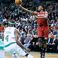 18 March 2013: Miami Heat point guard Norris Cole (30) passes the ball for a alley hoop to Miami Heat small forward LeBron James (6) during the Miami Heat 105-103 victory over the Boston Celtics at the TD Garden, Boston, Massachusetts, USA.