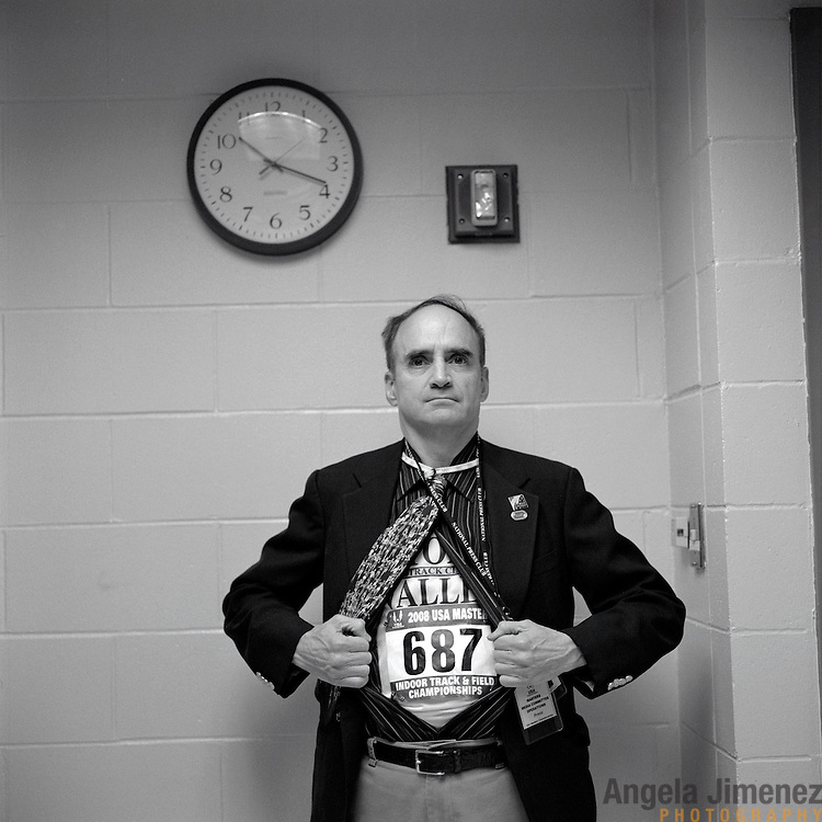 Date: 03/29/08.Desk: NAT.Slug: aging$500.Assign Id: 30081997A..Media relations representative and masters athlete Robert Weiner pulls back his professional outfit to show his racing number underneath before running in a race at the 2008 USA Masters Indoor Track & Field Championships at the Reggie Lewis Track & Athletic Center in Boston, Massachusetts on March 29, 2008...Photo by Angela Jimenez for The New York Times .photographer contact 917-586-0916