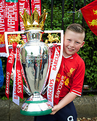 DUBLIN, REPUBLIC OF IRELAND - Wednesday, May 14, 2014: Liverpool supporter Brandon Horace, 11, from County Kildare gets his hands on the Premier League trophy  before a postseason friendly match against Shamrock Rovers at Lansdowne Road. (Pic by David Rawcliffe/Propaganda)