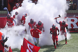 Sep 6, 2014; Piscataway, NJ, USA; Rutgers Scarlet Knights head coach Kyle Flood leads his team on the field before the first half at High Points Solutions Stadium.