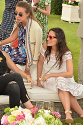 Left to right, MELISSA MILLS and PATRICIA HAIMES at the Cartier Queen's Cup Final 2016 held at Guards Polo Club, Smiths Lawn, Windsor Great Park, Egham, Surrey on 11th June 2016.