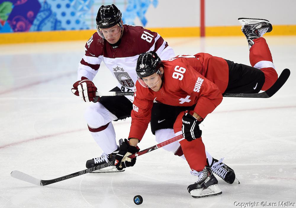 DK Caption: <br /> 20140212, Sochi, Rusland:  Vinter Olympiske Lege/Vinter OL i Sochi 2014: Isheckey herrer, Letland - Schweiz: Georgijs Pujacs, Letland, Latvia, Damien Brunner<br /> Foto: Lars M&oslash;ller<br /> UK Caption: <br /> 20140212, Sochi, Russia:  Sochi 2014 Winter Olympic Games: Icehockey Men, Latvia - Switzerland: Georgijs Pujacs, Letland, Latvia, Damien Brunner<br /> Photo: Lars Moeller