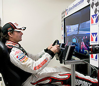 #24 Jeff Gordon has a little fun on the racing simulator prior to the Qualifying round held for the NASCAR Sprint Cup Series Sylvania 300 on Friday afternoon at New Hampshire Motor Speedway in Loudon.   (Karen Bobotas/for the Laconia Daily Sun)