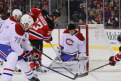 Feb 2; Newark, NJ, USA; Montreal Canadiens goalie Carey Price (31) makes a pad save on New Jersey Devils right wing David Clarkson (23) while losing his mask during the second period at the Prudential Center.