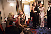 EMILY ROSE WETHERELL REPAIRING ESTHER KUHLMEY'S DRESS, THE 35TH WHITE KNIGHTS BALLIN AID OF THE ORDER OF MALTA VOLUNTEERS' WORK WITH ADULTS AND CHILDREN WITH DISABILITIES AND ILLNESS. The Great Room, Grosvenor House Hotel, Park Lane W1. 11 January 2014