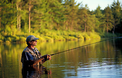 Freedom, New Hampshire..Fly-fishing in Trout Pond in New Hampshire's Lakes Region.  Hip waders.  Part of future town forest.