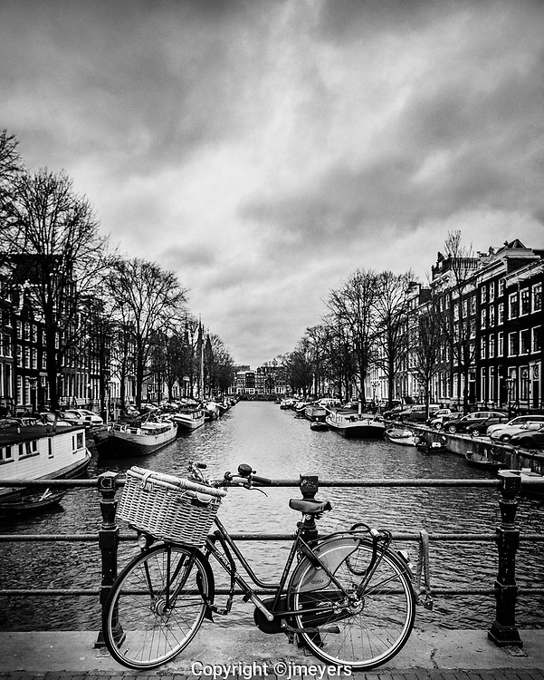Amsterdam, the city of canals, boats, barges and bikes