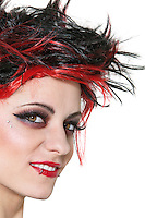 Close-up of beautiful punk woman smiling over white background