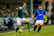 Steven Whittaker (#3) of Hibernian controls a long pass under pressure from Eros Grezda (#35) of Rangers during the Ladbrokes Scottish Premiership match between Hibernian and Rangers at Easter Road, Edinburgh, Scotland on 19 December 2018.