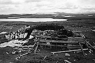 Freshly cut peat stacked on a stretch of land on the island of Lewis in the Outer Hebrides, Scotland. Peat cutting was a traditional method of gathering fuel for the winter in the sparsely-populated areas on Scotland's west coast and islands. The peat was dried and used in fires and ovens.