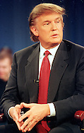 "Donald Trump listens to a question during a break in the taping of MSNBC's ""Hardball with Chris Matthews,"" at the University of Pennsylvania's Irvine Auditorium, Thursday, Nov. 18, 1999, in Philadelphia. Trump talked about the prospects of his running for President as the Reform Party candidate. (Photo by William Thomas Cain/photodx.com)"