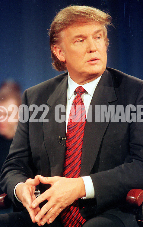 """Donald Trump listens to a question during a break in the taping of MSNBC's """"Hardball with Chris Matthews,"""" at the University of Pennsylvania's Irvine Auditorium, Thursday, Nov. 18, 1999, in Philadelphia. Trump talked about the prospects of his running for President as the Reform Party candidate. (Photo by William Thomas Cain/photodx.com)"""