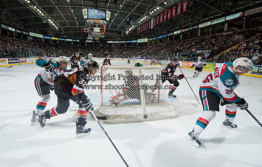 KELOWNA, CANADA - FEBRUARY 28: Gage Quinney #20 of Kelowna Rockets checksTravis Sanheim #32 of Calgary Hitmen behind the net of Brendan Burke #1 of Calgary Hitmen on February 28, 2015 at Prospera Place in Kelowna, British Columbia, Canada.  (Photo by Marissa Baecker/Shoot the Breeze)  *** Local Caption *** Brendan Burke; Gage Quinney; Travis Sanheim;