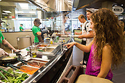 Allyson Miller orders at the new Noodled station, one of the many new options at Boyd Dinning Hall.