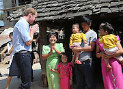 XISHUANGBANNA, CHINA - MARCH 04: (CHINA OUT) <br /> <br /> The Duke Of Cambridge Visits Yunnan's Xishuangbanna<br /> <br /> Prince William, Duke of Cambridge talks with villagers during his visit Dai Autonomous Prefecture of Xishuangbanna/Sipsongpanna on March 4, 2015 in Xishuangbanna, Yunnan province of China. The Duke of Cambridge is on a four-day visit to China. He is the first senior British royal to visit China since the Queen and Prince Philip visited in 1986. <br /> ©Exclusivepix Media